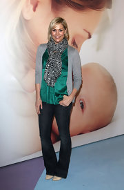 This animal print scarf added interest to Jenni's off-duty look at a baby show in London.