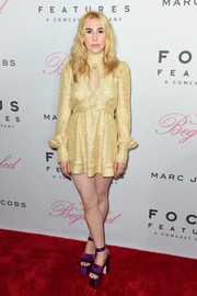 Zosia Mamet flashed plenty of leg and a bit of cleavage in this gold cutout mini dress by Marc Jacobs at the New York premiere of 'The Beguiled.'