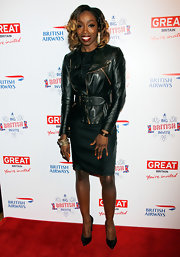 Estelle paired a sleek leather jacket over her LBD for a touch of edge on the red carpet.