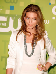 AnnaLynne provided a bold pop of color on the red carpet with canary yellow nails.