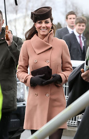 Kate Middleton stuck to her classic look with this salmon pink wool coat with asymmetrical neck.