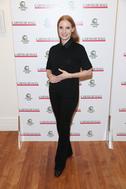 Jessica Chastain paired her top with black bootcut jeans.