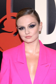 Emily Meade opted for a sleek side-parted updo when she attended the New York premiere of 'The Deuce.'