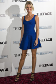 Caroline Winberg teamed black strappy sandals with a super-short bandage dress for an ultra-sexy finish at the 'Face' launch.