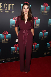 Crystal Reed donned a sleek burgundy Bec & Bridge jumpsuit with a bowed waist for the Sydney premiere of 'The Gift.'