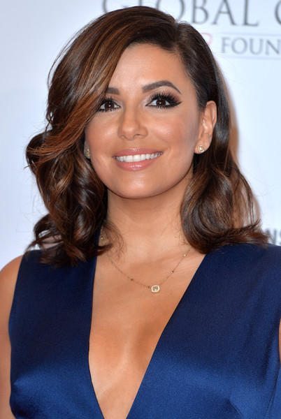 Eva Longoria contrasted her striking eye makeup with a subtle glossy lip.