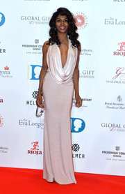 Sinitta put on a sultry display in a pale-pink cowl-neck gown during the Global Gift Gala.