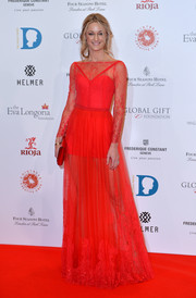 Storm Keating was a vision in a subtly embellished red gown during the Global Gift Gala.