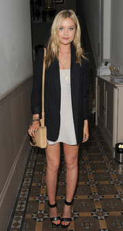 Laura Whitmore picked a beige leather handbag to pair with her sweet, polished getup at a lunch in London.