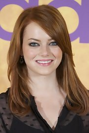 Emma Stone wore a subtle yet smoky eye at the 'Criadas y Senoras' photocall. To try her look at home, apply a pale, shimmering peach shadow all over eye lids. Next, swipe a line of black eye pencil along the top and bottom lash lines and the inner rims of eyes. To finish the look, apply several coats of a volumizing mascara.