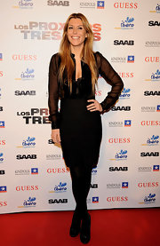 Raquel Merono looked sophisticated and sultry on the red carpet in black patent pumps paired with opaque tights.