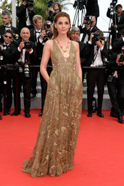 Clotilde Courau was a sight to behold in a gold lace Valentino gown with a deep-V neckline during the premiere of 'The Search.'