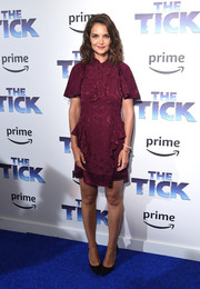 Katie Holmes kept it ladylike in a plum ruffle cocktail dress by Maison Mayle at the premiere of 'The Tick.'