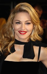 Madonna attended the UK premiere of 'W.E.' wearing a vibrant glossy red lipstick.