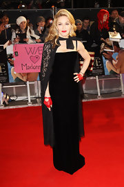 Madonna wore a black velvet column dress with a matching lace cape to the UK premiere of 'W.E.'