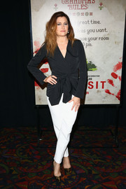 Kathryn Hahn went for casual sophistication in a black wrap top during the New York premiere of 'The Visit.'