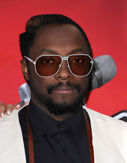 will.i.am opted for a modern take on classic aviators with these white rimmed shades.