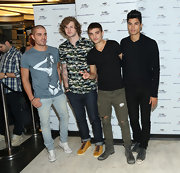 Max George stuck to a blue graphic-print tee for his look at a meet and greet with fans.