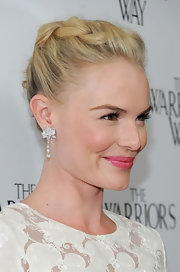 Kate Bosworth's elegant French twist is already a head-turner. The actress added sparkling diamond earrings that took her look to the limit.