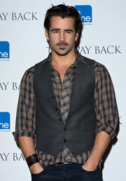 Colin Farrell added a nice layer to his plaid shirt with a gray vest.