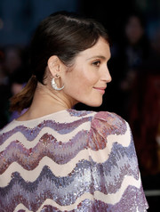 Gemma Arterton added a whimsical touch with a pair of moon earrings by Venyx.