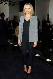 Taylor Schilling kept it smart in a striped blazer layered over a navy jumpsuit during the Theory fashion show.