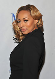 Keri Hilson wore her asymmetrical bob in shiny golden curls at a screening of 'Think Like a Man.'