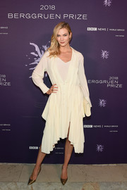 Karlie Kloss attended the Berggruen Prize Gala wearing a swingy ivory shirtdress.