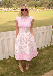 We are dying over the cuteness that is Kaley's pink and white laser cut dress at the polo classic!