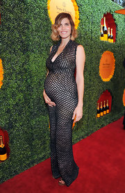 Talk about maternity style! Maternity showed off her new curves in this textured long dress.