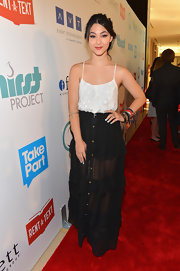 Fivel Stewart tucked a sheer embroidered spaghetti-strapped top inside her long skirt at The Thirst Project Gala.
