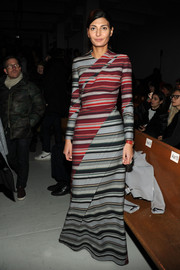 Giovanna Battaglia cut a bold figure in a multicolored striped maxi dress during the Thom Browne Women's fashion show.