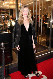Georgia May Jagger arrived for the Thomas Sabo flagship store opening in Hamburg wearing a black leather jacket over a maxi dress.