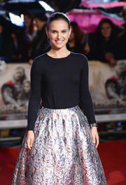 Natalie Portman went to the premiere of 'Thor: The Dark World' wearing a black crewneck sweater with a metallic skirt, both by Dior.