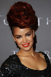 Check out the height Eva got with this deep red beehive!