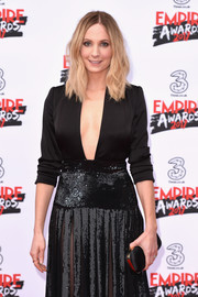 Joanne Froggatt arrived for the Three Empire Awards carrying a classic black satin clutch.