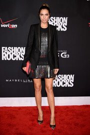 Amber Le Bon was tough-chic in a studded-lapel blazer layered over a metal-embellished mini during Fashion Rocks 2014.