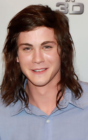 Logan Lerman wore his hair in a shoulder-length wavy style for the 'Three Musketeers' photocall.