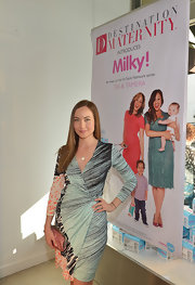 Courtney Ford rocked a long-sleeve printed dress while out at the launch of Milky! in Beverly Hills.