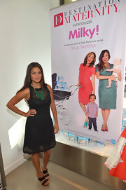 A little black dress with a cool chevron lace over lay gave Catherine Guidici a fun and flirty look at the launch of Milky!