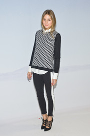 Olivia Palermo was preppy-chic in a black-and-white Tibi sweater layered over a button-down shirt during the Tibi fashion show.