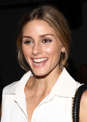 Olivia Palermo styled her hair in a simple loose ponytail for the Tibi fashion show.