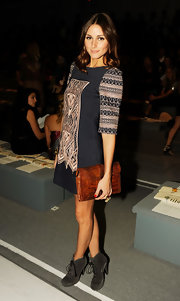 Olivia showed off her favorite pair of grey suede ankle boots while hitting the Tibi fashion show.