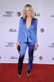 Malin Akerman teamed her suit with modern black T-strap sandals by Olgana Paris.