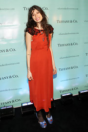 Pamela Love wore a delicately beaded dress in a bright hue to the launch of True Love in Pictures.