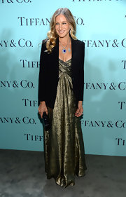 Sarah Jessica Parker added a cool contemporary touch to her romantic dress with this structured black blazer.
