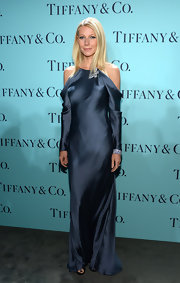 Gwyneth stunned in a steel blue silk dress that showed off the star's shoulders.
