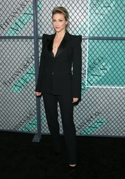 Lili Reinhart suited up in black Michael Kors for the launch of the new Tiffany Men's Collection.