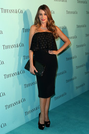 Sofia Vergara matched her dress with a studded black clutch.