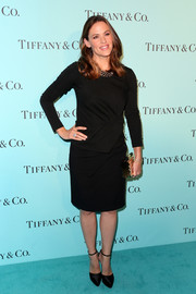 For her shoes, Jennifer Garner chose a pair of Casadei satin platform pumps, also in black.